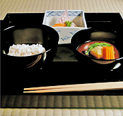 a tray with japanese food